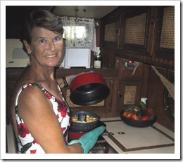 Mary Heckrotte baking in Camryka's galley