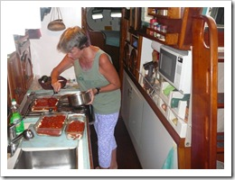 Gwen prepares enchiladas in Tackless ii's galley