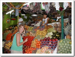 Gwen Hamlin practicing Spanish in a market iin Mexico