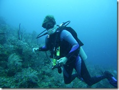 Sherry McCampbell of sv Soggy Paws diving Utila, Honduras