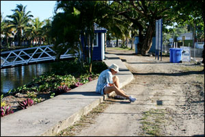 John putting on his running shoes as we leave the marina (Apia, Samoa)