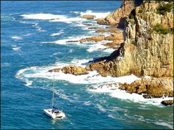 Dai Long Wan going out through the tricky pass out of Knysna in South Africa. Photo taken by a Knysna Yacht Club member