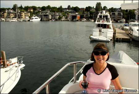 Lisa relaxing on the flybridge of Kismet, in their homeport of Charlevoix, Michigan,  just before taking off on their second Loop.