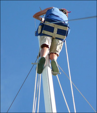 Gwen Hamlin up the mast in bosun chair