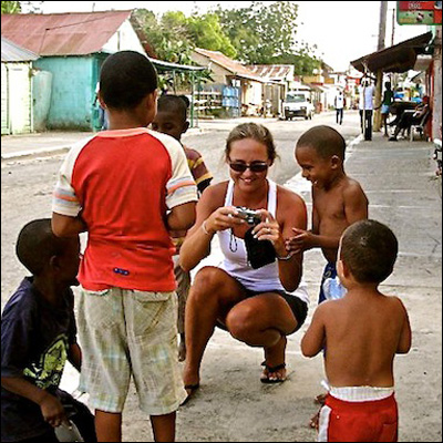 Brittany entertaining some local children with her photos in Luperon, DR