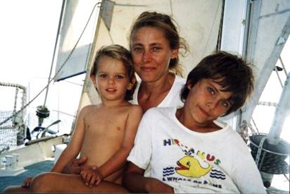 Young naked boys sailing
