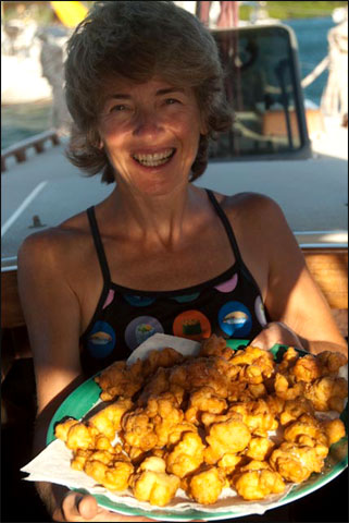 Ann Vanderhoof with the fritters she made from lambi (conch)