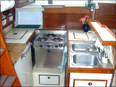 Tiny interiors kitchen on pinterest tiny kitchens for Boat galley kitchen designs
