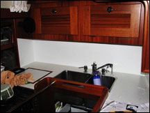 White Formica installation in Mahina Tiare galley